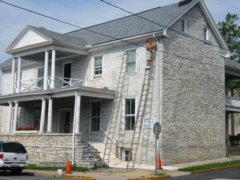 Painter Garry Orebaugh, Jr. works on restoring the facade of the Marshall House